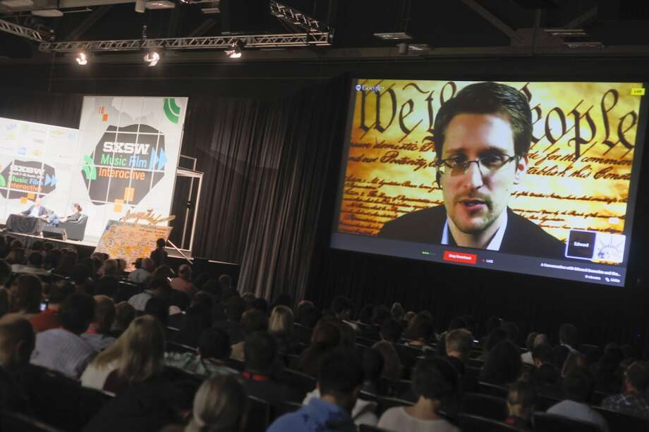 Former National Security Agency contractor Edward Snowden, pictured at a simulcast conversation during the SXSW Interactive Festival, changed the way we think about online privacy in 2013 when he leaked  records  about an NSA surveillance program that taps telephones and seizes records from Internet companies. Photo: Jack Plunkett, Associated Press