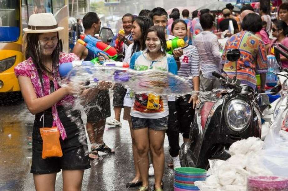Songkran Water FestivalWhen: April 13–15 (for 2014)Where: Chiang Mai, ThailandImagine the ultimate water fight with an entire country participating in the festivities. That's exactly what the Songkran Water Festival is: a six-day all out water fight. The festival is actually a New Years celebration for Thailand, but tourists have come to enjoy the festivities just as much as the locals (with the most famous celebrations taking place in Chiang Mai and Bangkok.) Participants are ready to soak anyone in their vicinity and also smear talc on the faces and bodies of passerby's as a blessing for the New Year. Photo: Jack Kurtz, Getty Images