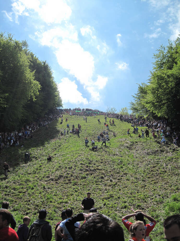 Cooper's Hill Cheese RollWhen: Spring Bank Holiday, May 26 (for 2014)Where: Gloucestershire, EnglandThe name of this event is exactly what it implies, people race down a steep hill while following a large block of round cheese rolling down. Sound like fun? The first person to cross the finish line wins a Double Gloucester cheese.Dating back hundreds of years, this festival is thought to have been an ancient fertility rite or a way of guaranteeing the rights of the villagers to graze their livestock on the land. Today, it's just a fun way to be entertained, for both cheese lovers and non alike. Photo: Bladeflyer, Flickr
