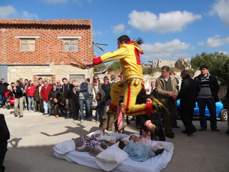 "El ColachoWhen: June 19-23 (for 2014)Where: Castrillo de Murcia, SpainThis festival is called El Colacho to locals but internationally it's referred to as ""the baby jumping festival."" Yes you read that right. During this festival, men dressed as the devil in red and yellow jumpsuits jump over a row of up to 10 babies. (Photo: Fest300