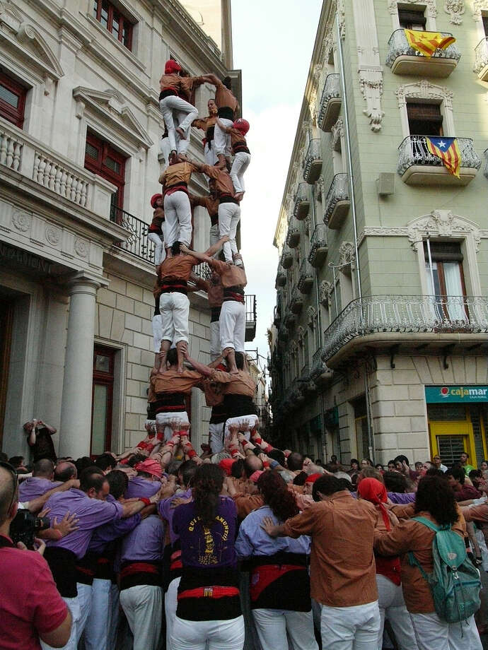 Human Tower BuildingWhen: between April and November Where: Catalonia, SpainImagine human pyramids but on steroids. Castellers are people who form giant human towers at festivals all around Catalonia, Spain. The tradition began more than 200 years ago and today there more than 7,000 castellers in clubs around the country keeping this tradition alive.This definitely isn't for the timid though but would make a great vacation photo! (Photo: Fest300) Photo: Passion Leica, Flickr