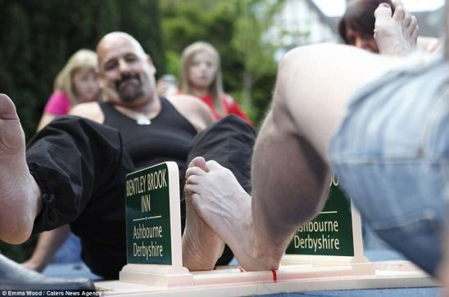 "World Toe Wrestling ChampionshipWhen: JulyWhere: Derbyshire, EnglandHave you ever heard of the World Toe Wrestling Championship? Similar to arm wrestling, contestants compete by locking toes and attempting to pin the opponent's feet. The competition lasts for three rounds and the best out of three wins. These toe wrestlers aren't messing around; the three-time champion calls himself the ""Toeminator."" Want to check out the action? Just Google it to see the kind of toe action that takes place. Photo: Caravanum, Flickr"