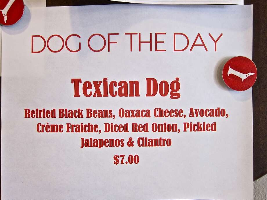 Dog of the Day sign on the specials board at Good Dog Houston. Photo: Alison Cook