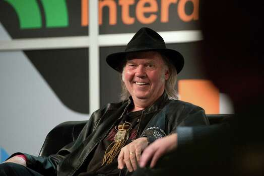 Musician Neil Young, founder and chairman of PonoMusic, smiles during a featured session at the South By Southwest (SXSW) Interactive Festival in Austin, Texas, U.S., on Tuesday, March 11, 2014. The SXSW conferences and festivals converge original music, independent films, and emerging technologies while fostering creative and professional growth. Photographer: David Paul Morris/Bloomberg *** Local Caption *** Neil Young Photo: David Paul Morris, Bloomberg / © 2014 Bloomberg Finance LP
