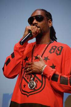 "AUSTIN, TX - MARCH 11:  Rapper Snoop Dogg takes part in a Q&A following the ""Take Me To The River"" premiere at the 2014 SXSW Music, Film + Interactive Festival at the Topfer Theatre at ZACH on March 11, 2014 in Austin, Texas. Photo: Michael Loccisano, Getty Images For SXSW / 2014 Getty Images"