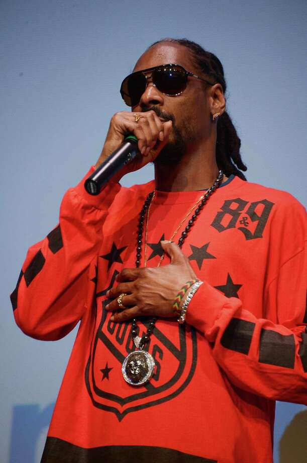 """AUSTIN, TX - MARCH 11:  Rapper Snoop Dogg takes part in a Q&A following the """"Take Me To The River"""" premiere at the 2014 SXSW Music, Film + Interactive Festival at the Topfer Theatre at ZACH on March 11, 2014 in Austin, Texas. Photo: Michael Loccisano, Getty Images For SXSW / 2014 Getty Images"""