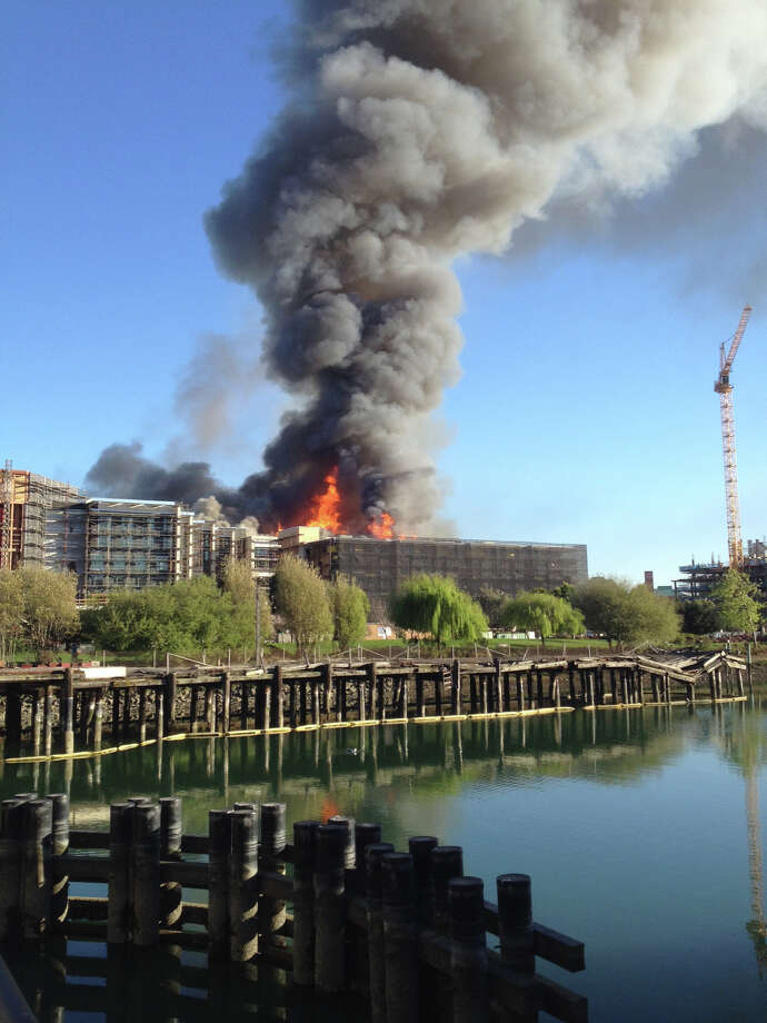 A huge plume of smoke rises above a fire at an apartment building complex under construction in San Francisco's Mission Bay. Photo: Courtesy Julia Coburn Nagle