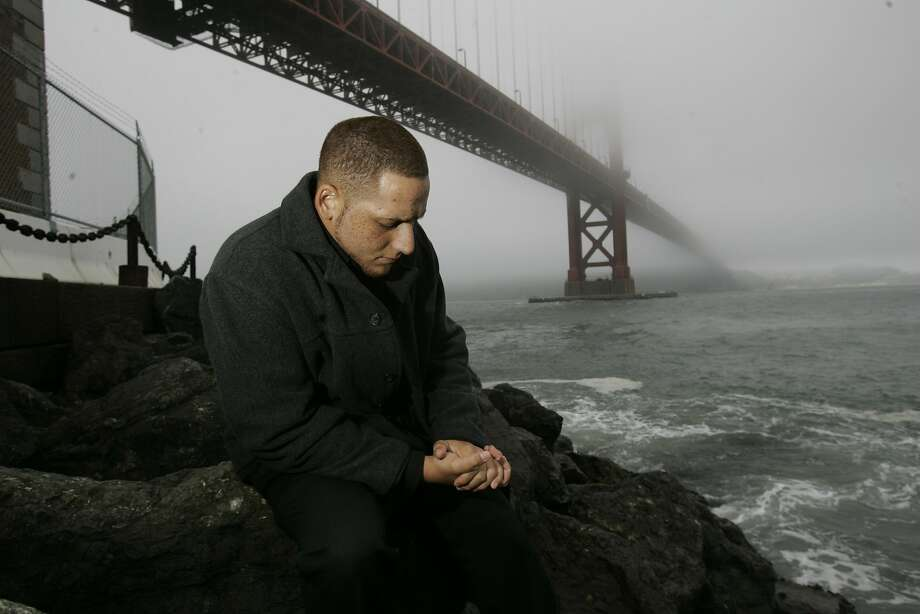 Kevin Hines, on the rocks next to Fort Point underneath  the Golden Gate Bridge. He survived jumping off of the bridge in a suicide attempt. Kevin Hines was 19, with a history of depression, when he plunged over the bridge's guardrail, then decided he wanted to live. He became one of only 26 known survivors  --  and found his mission.  Photo: John Storey, SFC