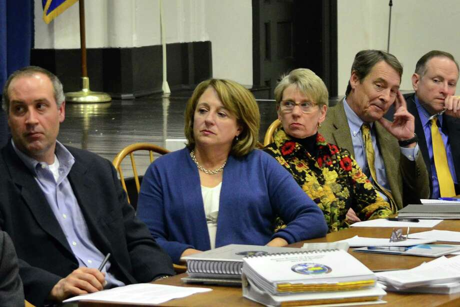 The Board of Finance all turned to listen to each of the residents that either spoke in favor or against the proposed 2014-15 municpal budget on Tuesday, March 11 at the Darien Town Hall. Photo: Megan Spicer / Darien News