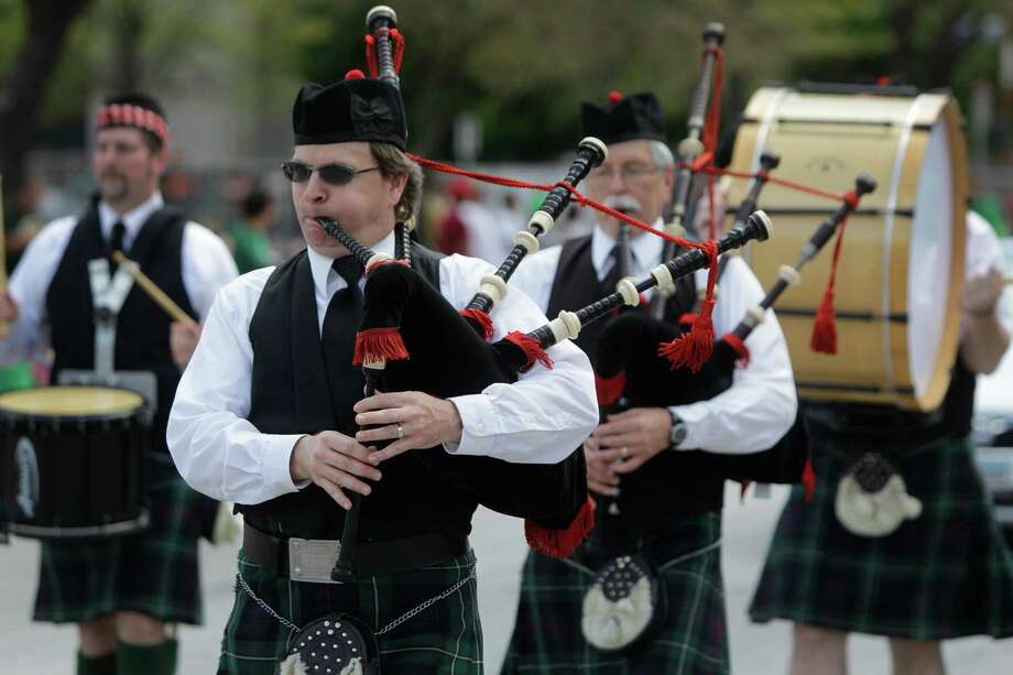 Bagpipers and drummers perform during the 54th annual Houston St. Patrick's Day Parade Saturday, March 16, 2013, in Houston. ( Melissa Phillip / Houston Chronicle ) Photo: Melissa Phillip, Staff / © 2013  Houston Chronicle