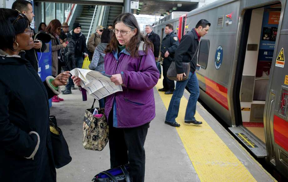 Metro-North riders look for an alternate route to their destination as they wait on a platform at the Stamford train station on Wednesday, March 12, 2014, after train service was suspended due to an explosion in Harlem. Photo: Lindsay Perry / Stamford Advocate