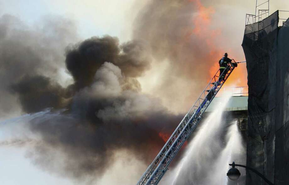 A fire rages in an apartment building complex in the Mission Bay of San Francisco, Calif. on March 11, 2014. Photo: Deborah Svoboda, The Chronicle / Deborah Svoboda / ONLINE_YES
