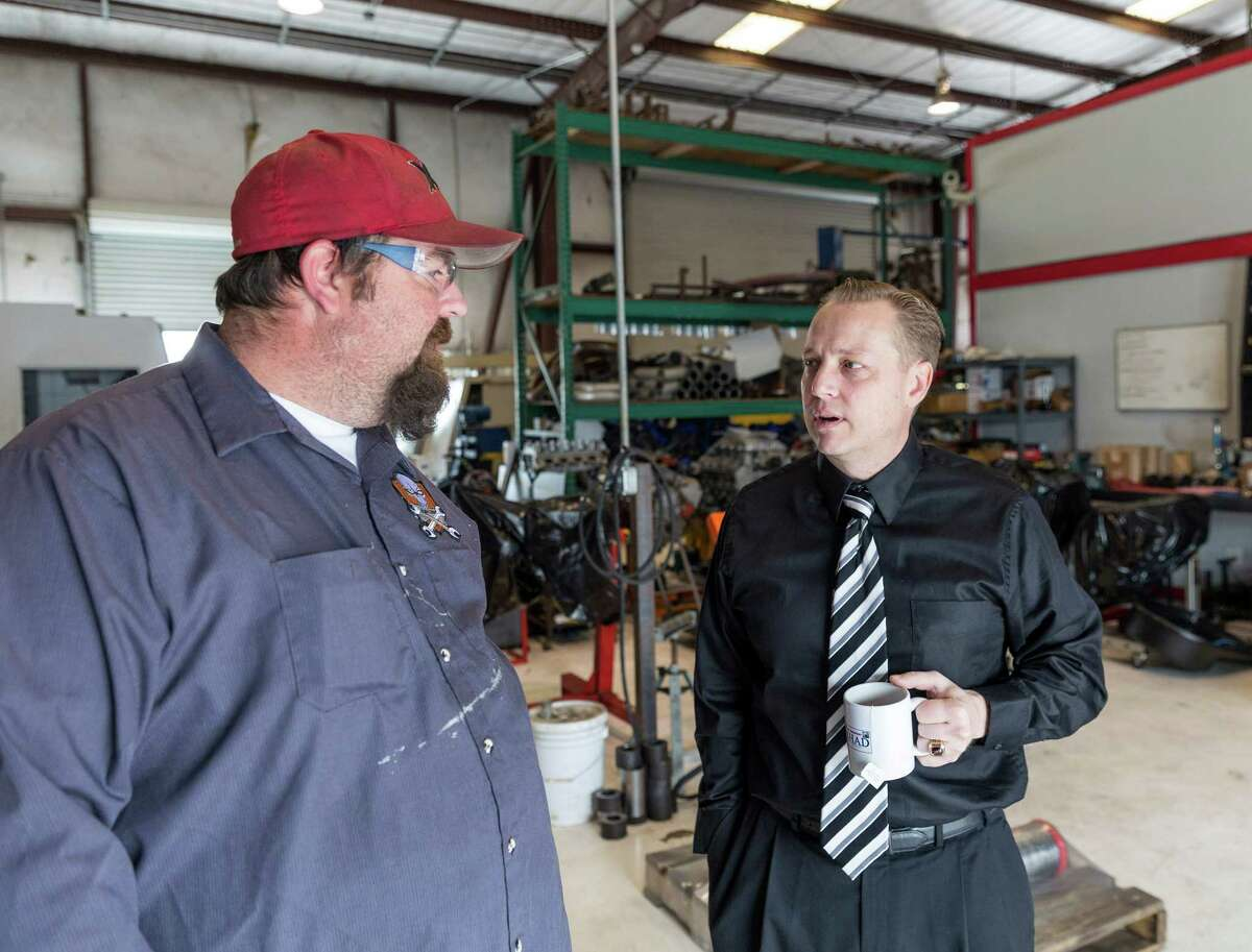 """""""Gear Heads"""" is a TV show about the creators of modern muscle cars at a Houston garage called Fastlane, 10400 W. Montgomery Road. L-R ID: one of the two garage owners, Rick Ford, talks to producer James Ganiere, about the show. 3/07/14 (Craig H. Hartley/For the Chronicle)"""