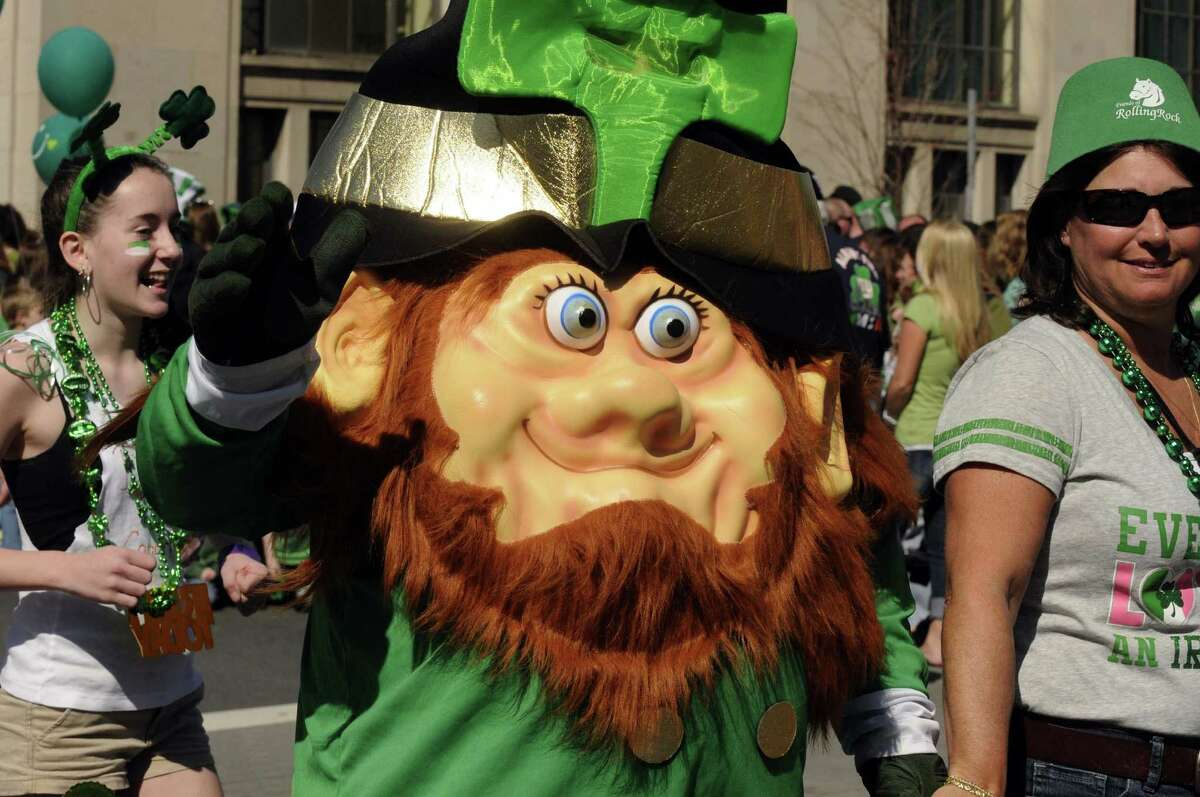 A leprechaun character marches in the 62nd Annual Albany St. Patrick's Parade in Albany, NY Saturday March 17, 2012.( Michael P. Farrell/Times Union )