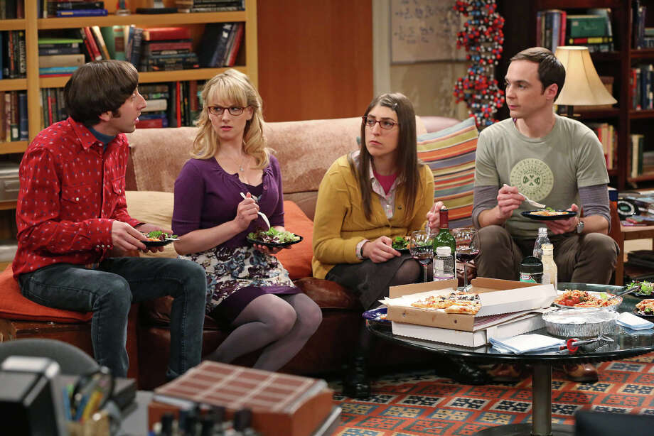 "This image released by CBS shows, from left, Simon Helberg, Melissa Rauch, Mayim Bialik and Jim Parsons in a scene from ""The Big Bang Theory."" CBS says it's renewing its hit comedy ""The Big Bang Theory"" for three more years. This extraordinary deal would carry TV's most-watched sitcom through the 2016-2017 season, the series' tenth on the air. ""The Big Bang Theory"" premiered in September 2007, and has been a ratings smash for virtually its entire run. This season it has averaged nearly 20 million viewers each week. Photo: Michael Yarish, AP / CBS"