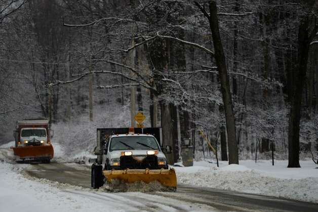 Trucks clear snow from North Broadway in Saratoga Springs. (Skip Dickstein/Times Union)