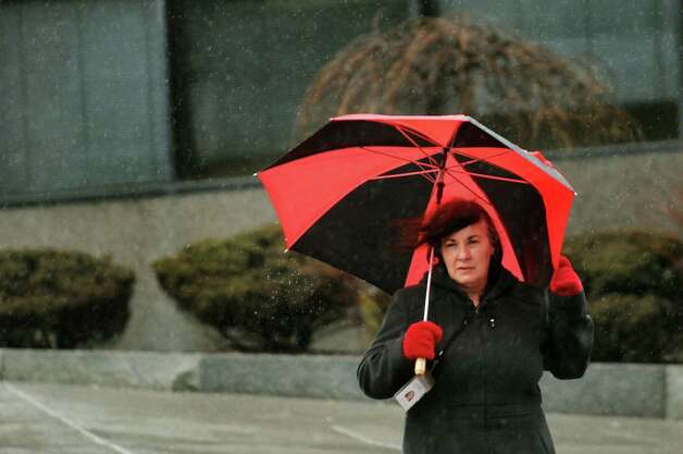 Jody Winnie of Rensselaer shields herself from the wind and rain as she crosses North Pearl Street on Wednesday, March 12, 2014, in Albany, N.Y. (Cindy Schultz / Times Union) Photo: Cindy Schultz / 00026108A