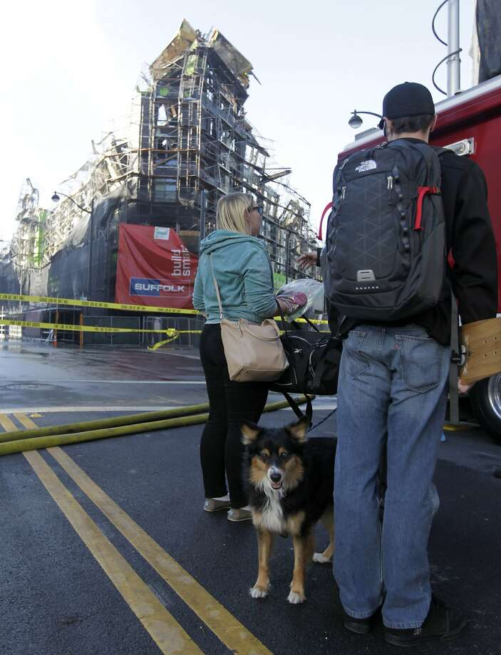 Heather and Adam Reese wait with their dog Maya to see when they can return to their apartment building across the street from the fire scene in San Francisco, Calif. on Wednesday, March 12, 2014. Photo: Paul Chinn, The Chronicle