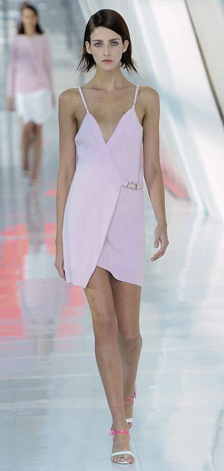 Pastel pink is primed to be spring's breakout pastel as in this simple spaghetti-strapped dress in the Preen collection. / 2013 Catwalking