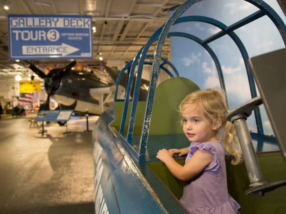 Sophie Tedesco sits in a cockpit replica at the USS Lexington military museum in Corpus Christi. Photo: John Tedesco, San Antonio Express-News