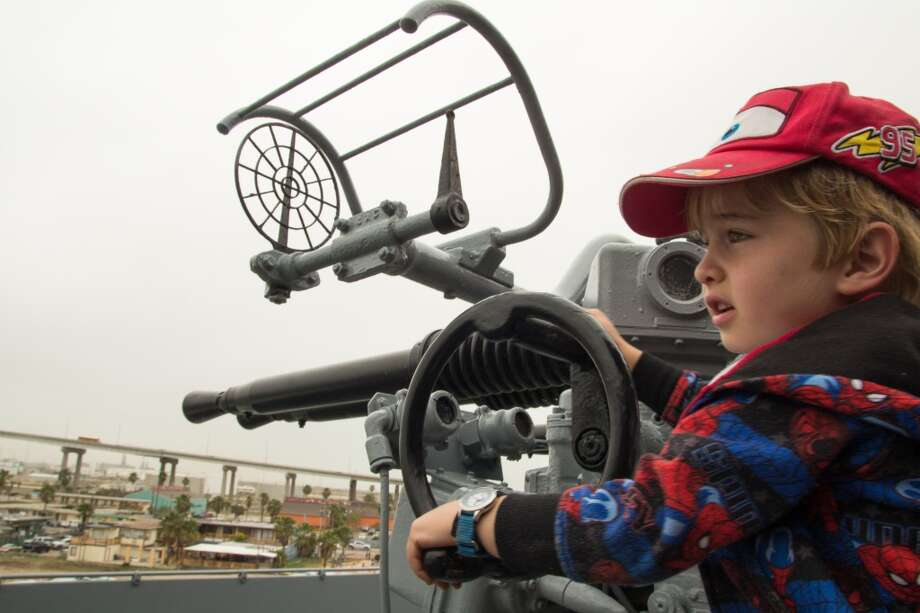 Pete Tedesco, 4, mans anti-aircraft guns on the USS Lexington, a World War II-era carrier that is now a military museum in Corpus Christi. Photo: John Tedesco, San Antonio Express-News