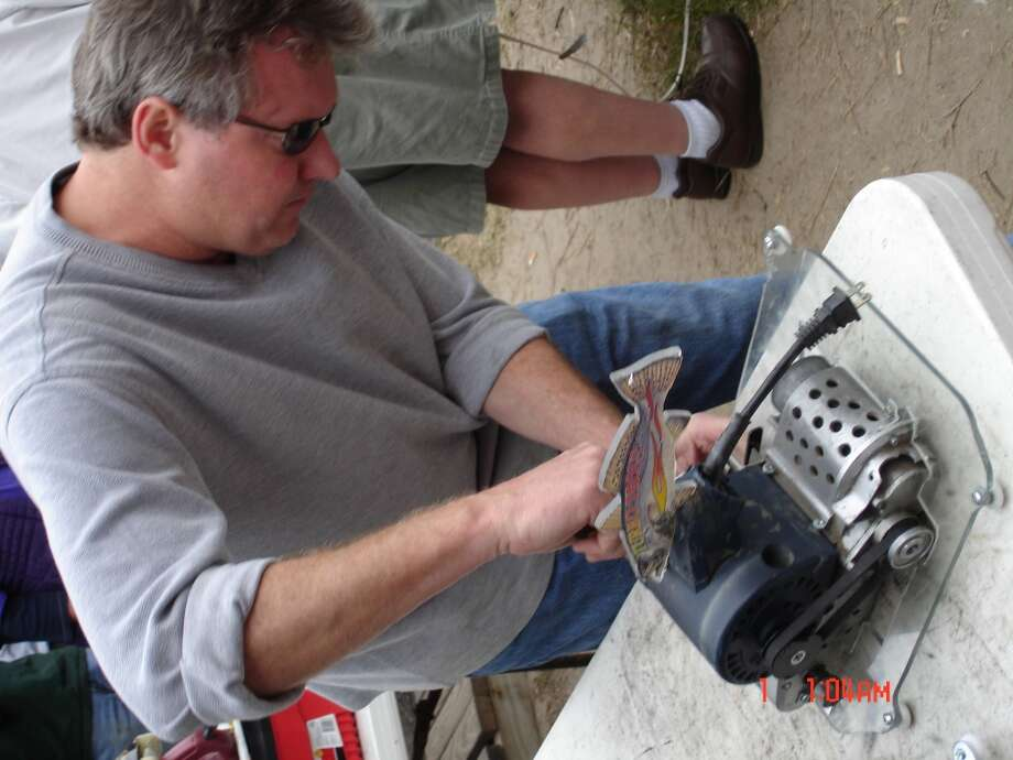 David Zuefeldt, of Austin, tweaks his belt sander, Turbo Trout, which he races at The Gaff in Port Aransas. Photo: Audrey Lee, San Antonio Express-News