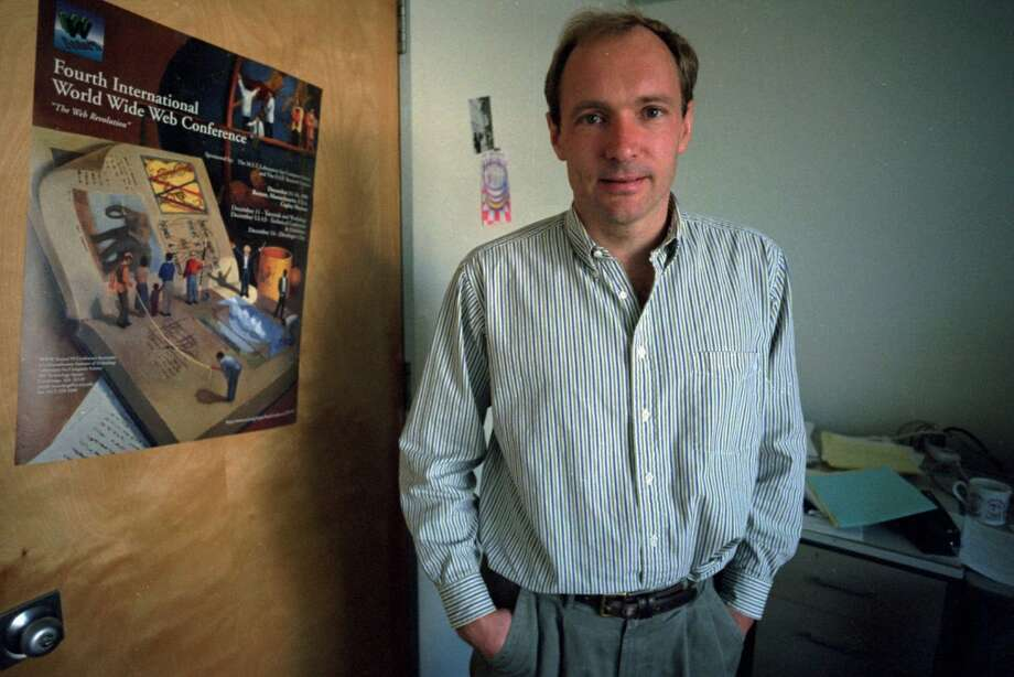 A software engineer and programmer, Tim Berners-Lee worked for more than a decade to develop the World Wide Web, first for his own use and then for physicists around the world. He is pictured posing in his Massachusetts Institute of Technology office Oct. 2, 1995, in Cambridge, Mass. Photo: STEPHAN SAVOIA, Associated Press
