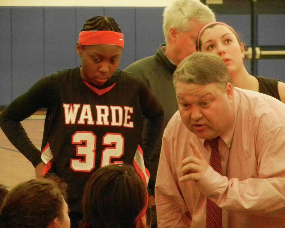 Fairfield Warde girls basketball coach Dave Danko speaks to the Mustangs during a timeout on Thursday, March 6 in Middletown during Warde's 37-22 loss at Mercy in the second round of the CIAC Class LL girls basketball tournament. Photo: Reid L. Walmark / Fairfield Citizen
