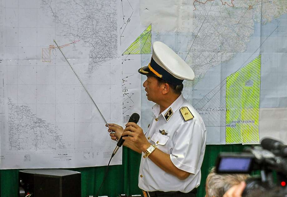 Vietnamese Deputy Commander Rear Admiral Le Minh Thanh points to the area where Vietnam is searching for the missing Malaysia Airlines jet. Photo: Le Quang Nhat, AFP/Getty Images