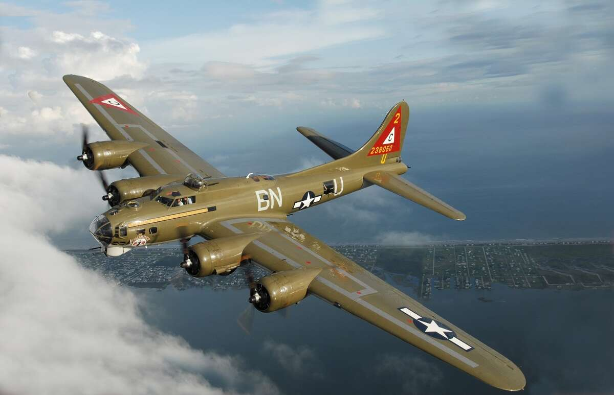 A B-17 Flying Fortress bomber flying high over Galveston Bay, the World War II classic survived the storm surge of hurricane Ike which caused $20m of damage at the Lone Star Flight Museum.