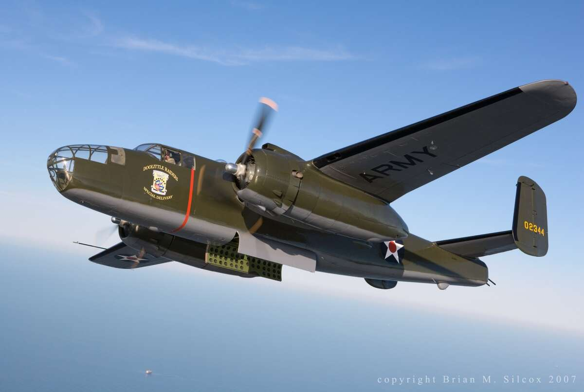 A B-25 Mitchell bomber flies over Galveston Bay, the World War II classic survived the storm surge of hurricane Ike which caused $20m of damage at the Lone Star Flight Museum.