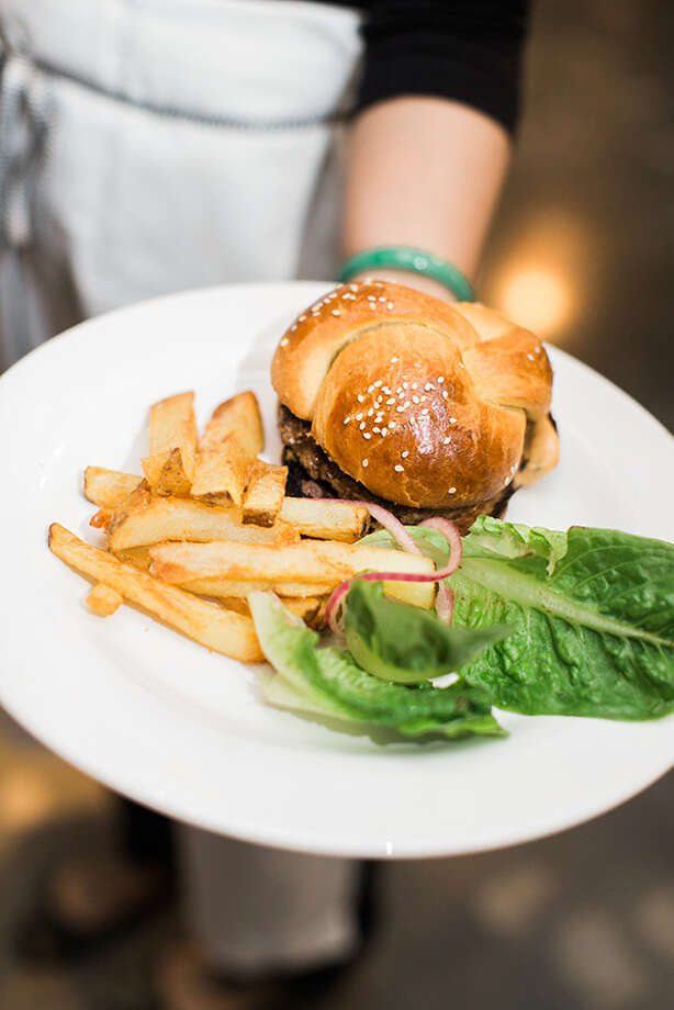 The West Coast Burger: Home made brioche bun, cheddar, lettuce, pickled onions, secret sauce and fries ($11) Photo: Nicole Nelson Photography