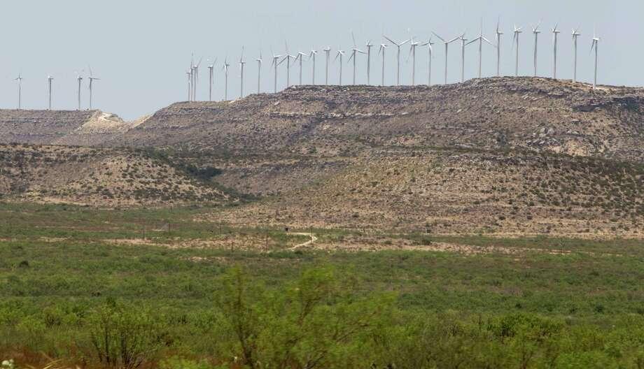 Wind turbines line a bluff in far west Texas near Rankin in 2011. Photo: Brett Coomer, Staff / © 2011 Houston Chronicle