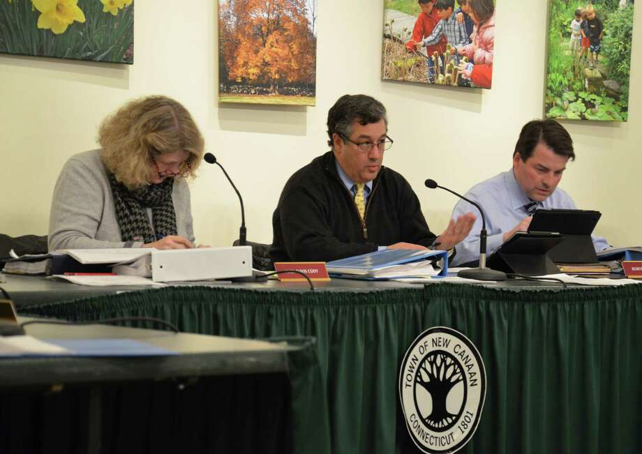 Board of Finance members Mary David Cody, Robert Mallozzi and Robert Spangler at a Feb. 27, 2014, meeting at the Nature Center in New Canaan, Conn. The board has agreed to recommend a 4.8 percent budget for the 2014-15 fiscal year. Photo: Nelson Oliveira / New Canaan News