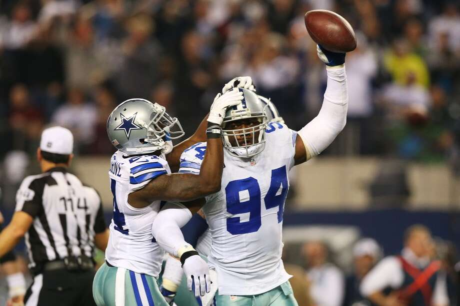 DeMarcus Ware #94 and Morris Claiborne #24 of the Dallas Cowboys celebrate in the second half against the Philadelphia Eagles at Cowboys Stadium on December 29, 2013 in Arlington, Texas. Photo: Ronald Martinez, Getty Images