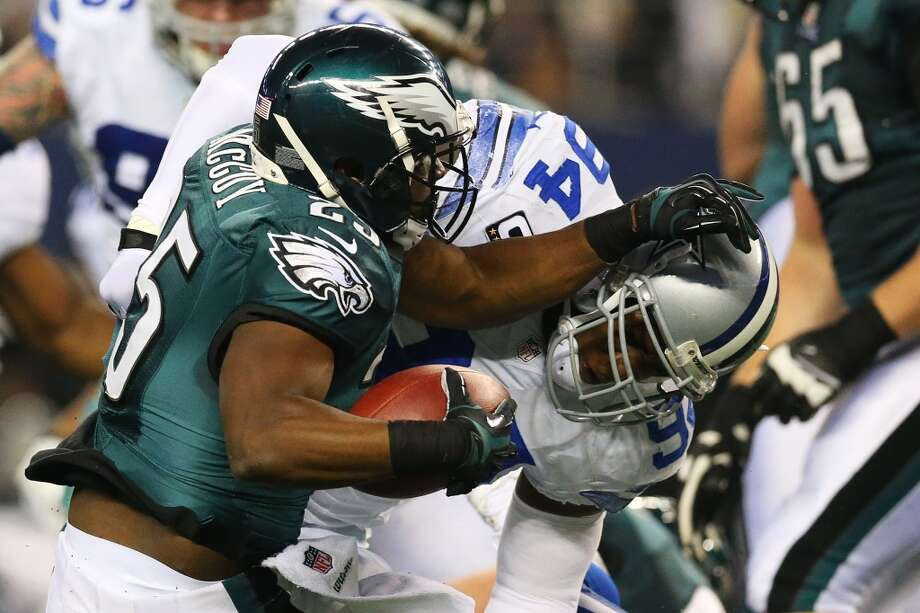 LeSean McCoy #25 of the Philadelphia Eagles tries to avoid the tackle of DeMarcus Ware #94 of the Dallas Cowboys in the first half at Cowboys Stadium on December 29, 2013 in Arlington, Texas. Photo: Ronald Martinez, Getty Images