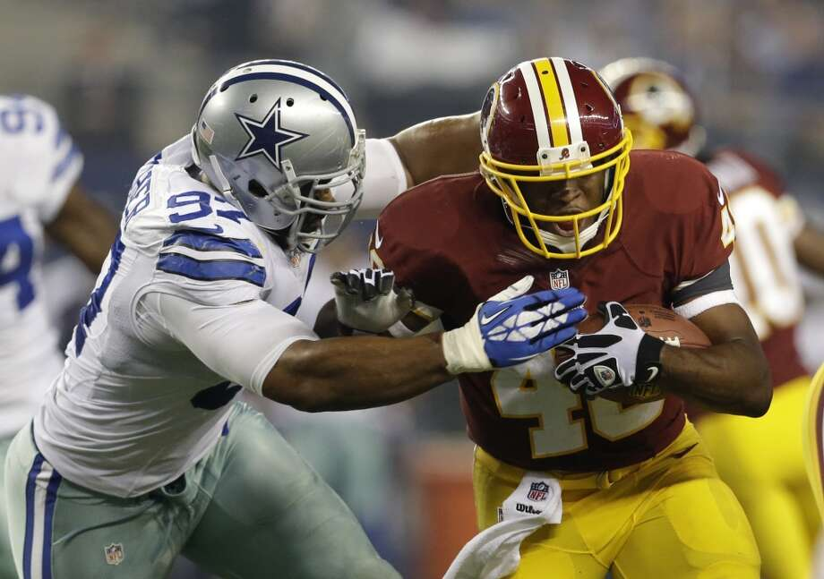 Dallas Cowboys defensive end DeMarcus Ware (94) chases down Washington Redskins running back Alfred Morris (46) in the first half of an NFL football game, Sunday, Oct. 13, 2013, in Arlington, Texas. Photo: LM Otero, Associated Press