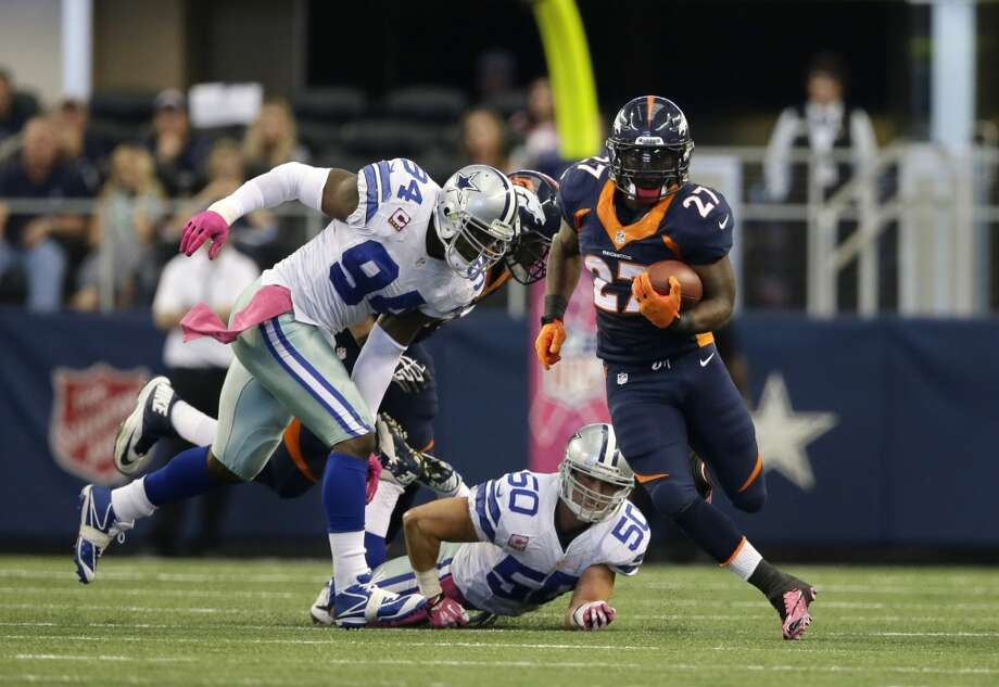 Denver Broncos running back Knowshon Moreno (27) escapes tackle attempts by Dallas Cowboys' DeMarcus Ware (94) and Sean Lee (50) as Knowshon gains extra yardage on a running play during the second quarter of an NFL football game, Sunday, Oct. 6, 2013, in Arlington, Texas. The Broncos won 51-48. Photo: Tony Gutierrez, Associated Press