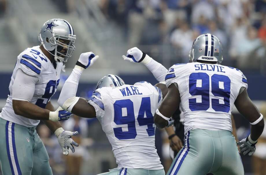Dallas Cowboys defensive end DeMarcus Ware (94) celebrates his sack against St. Louis Rams quarterback Sam Bradford with teammates Jason Hatcher (97) and George Selvie (99) during the first quarter of a NFL football game Sunday, Sept. 22, 2013, in Arlington, Texas. Photo: LM Otero, Associated Press