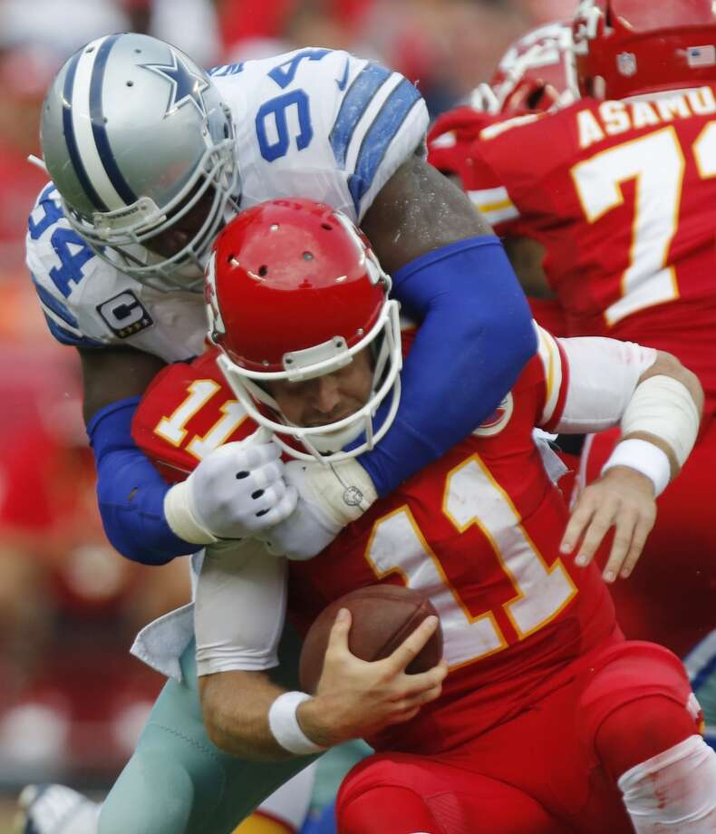Kansas City Chiefs quarterback Alex Smith (11) is sacked by Dallas Cowboys defensive end DeMarcus Ware (94) during the first half of an NFL football game at Arrowhead Stadium in Kansas City, Mo., Sunday, Sept. 15, 2013. Photo: Ed Zurga, Associated Press