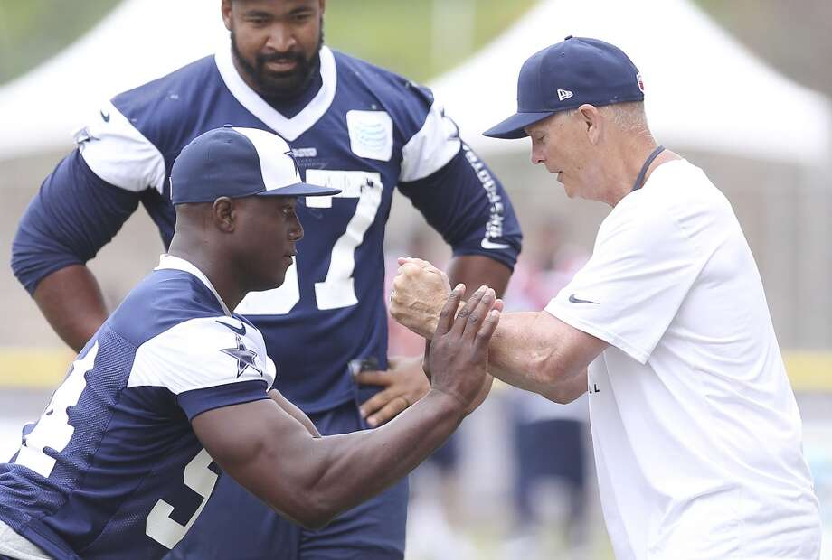 Defensive end DeMarcus Ware (left) works on drills with defensive line coach Rod Marinelli during the morning session of the 2013 Dallas Cowboys training camp on Thursday, Aug. 1, 2013 in Oxnard. Photo: Kin Man Hui, San Antonio Express-News