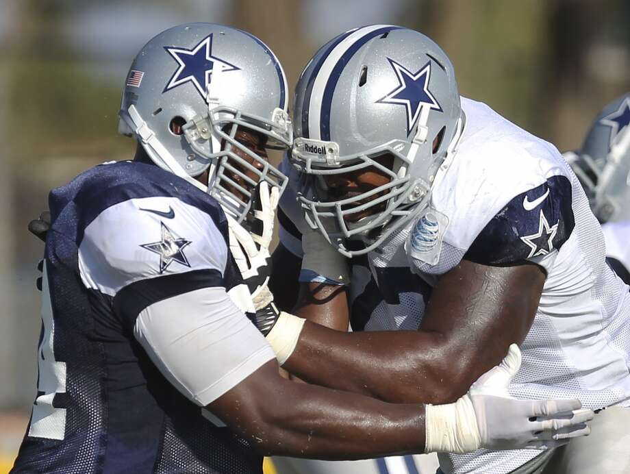 Defensive end DeMarcus Ware (left) works on offensive tackle Tyron Smith (right) during the afternoon session of the 2013 Dallas Cowboys training camp on Monday, July 29, 2013 in Oxnard. Photo: Kin Man Hui, San Antonio Express-News