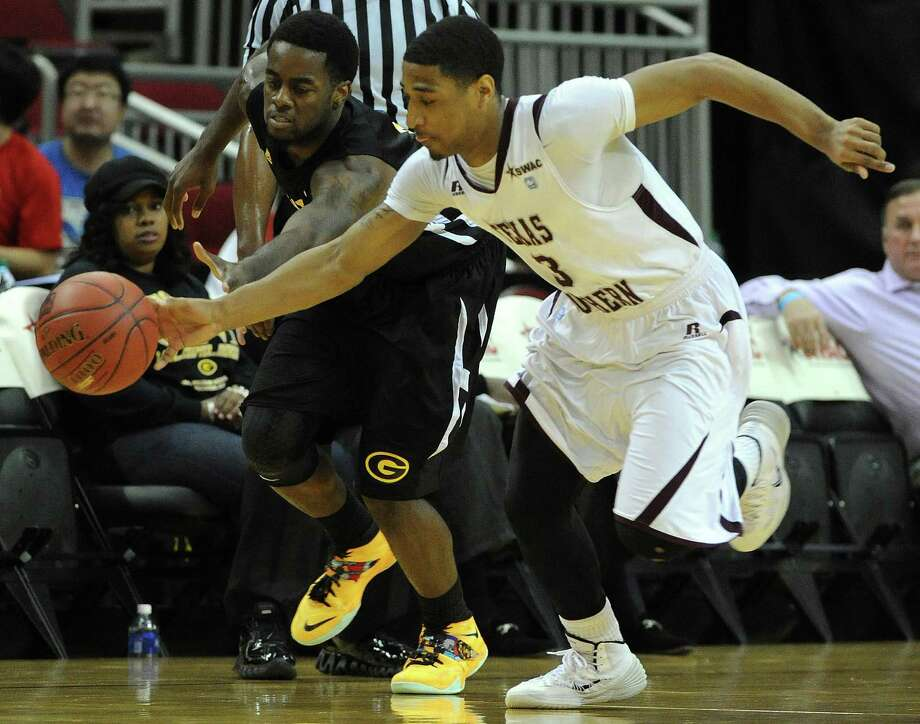 TSU's Madarious Gubbs, right, chases down a loose ball with Grambling's A'Torri Shine during the first half of a SWAC basketball tournament quarterfinal game, Wednesday, March 12, 2014, at Toyota Center in Houston. Photo: Eric Christian Smith, For The Chronicle
