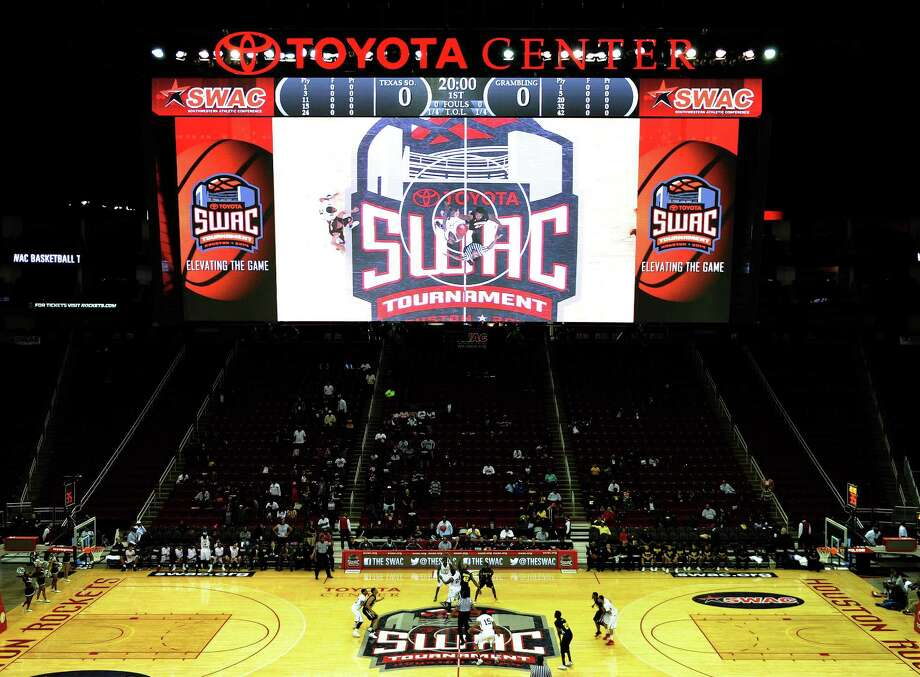 The opening tipoff between TSU and Grambling is shown on the video screen during the first half of a SWAC basketball tournament quarterfinal game, Wednesday, March 12, 2014, at Toyota Center in Houston. Photo: Eric Christian Smith, For The Chronicle