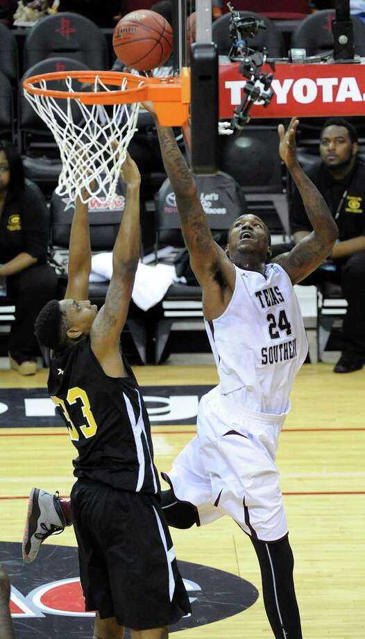 TSU's Aaric Murray, right, shoots past Grambling's Windal Glinton during the first half of a SWAC basketball tournament quarterfinal game, Wednesday, March 12, 2014, at Toyota Center in Houston. Photo: Eric Christian Smith, For The Chronicle