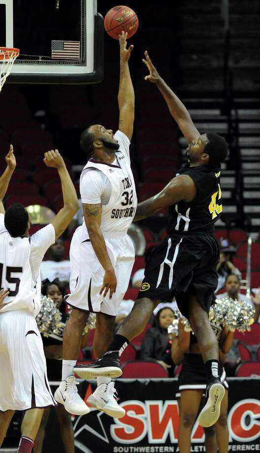 TSU's Aaron Clayborn, left, blocks the shot of Grambling's Steven Danridge during the first half of a SWAC basketball tournament quarterfinal game, Wednesday, March 12, 2014, at Toyota Center in Houston. Photo: Eric Christian Smith, For The Chronicle