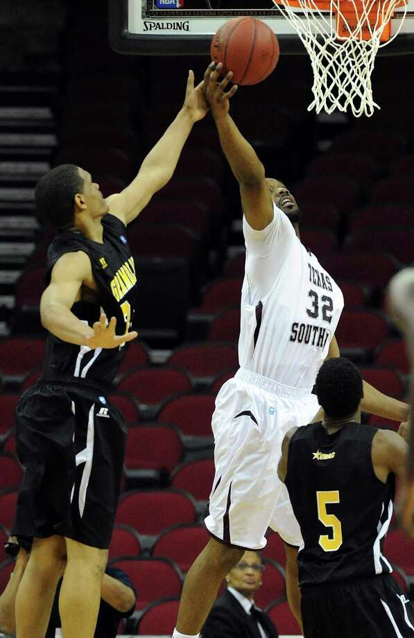 TSU's Aaron Clayborn (32) fights for a rebound with Grambling's Richard Freemin, left, during the second half of a SWAC basketball tournament quarterfinal game, Wednesday, March 12, 2014, at Toyota Center in Houston. Photo: Eric Christian Smith, For The Chronicle