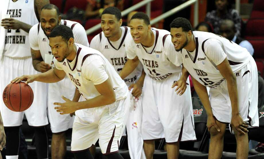 Texas Southern 79, Grambling State 54TSU's Tyree Bynum, left, dribbles the ball as his teammates on the bench cheer him on during the second half of a SWAC basketball tournament quarterfinal game against Grambling, Wednesday, March 12, 2014, at Toyota Center in Houston. Photo: Eric Christian Smith, For The Chronicle