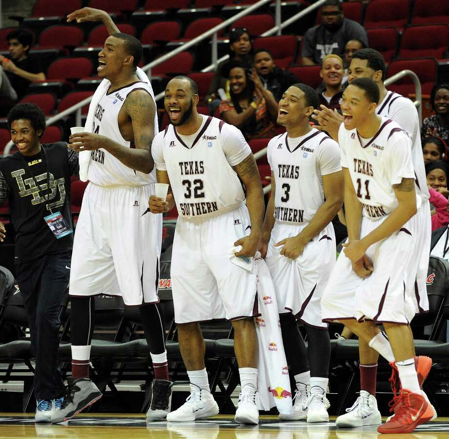 TSU's Aaron Clayborn (32) and teammates cheer a Tigers' two points from the bench during the second half of a SWAC basketball tournament quarterfinal game against Grambling, Wednesday, March 12, 2014, at Toyota Center in Houston. Photo: Eric Christian Smith, For The Chronicle