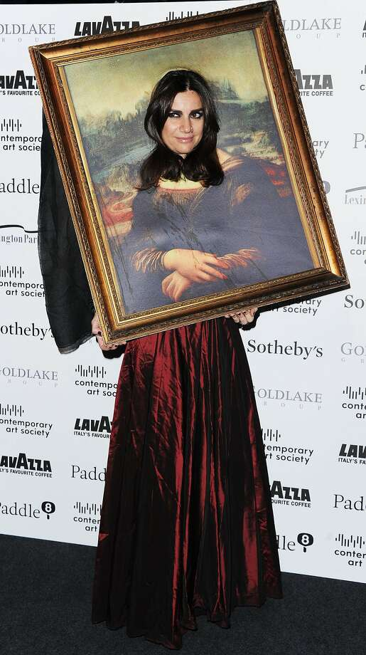 Renaissance woman: Flavia Nespatti shows off her Mona Lisa smile at the Contemporary Art Society Fundraising Gala at Tobacco Dock in London. Photo: Stuart C. Wilson, Getty Images